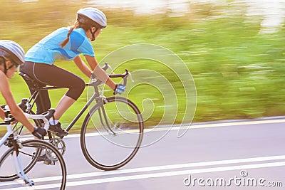 Training process of the two female caucasian sportswomen riding