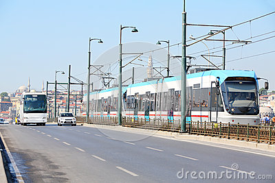 Tram, bus and car at sunny summer day