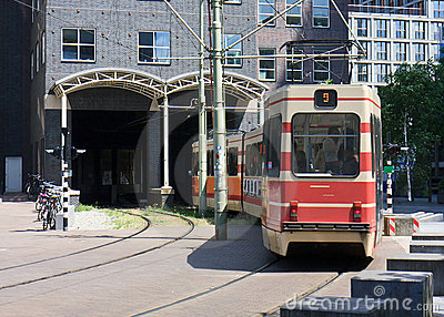 Tram entering inside a building