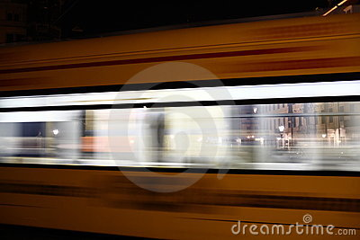 Tram passing by at night