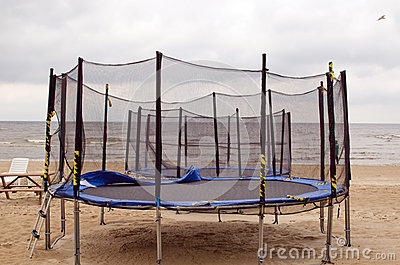 Trampolines on beach sea sand. Active recreation.