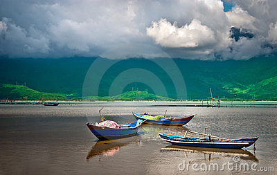 Tranquil bay with wooden boats in Vietnam