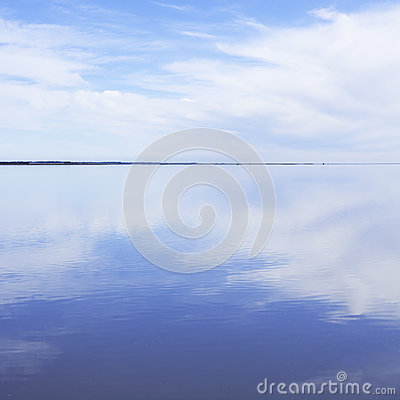 Tranquil Lake with Clouds Reflecting
