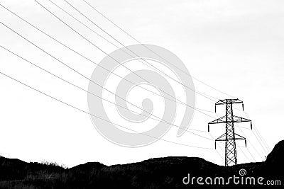 Transmission tower with high voltage wires in dark