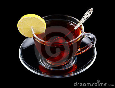 Transparent cup of tea with spoon and lemon
