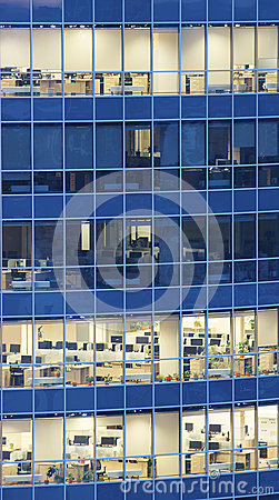 Transparent glass wall of business center with offices