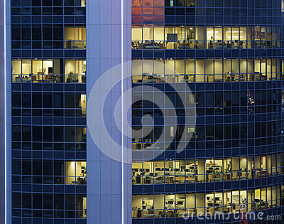 Transparent glass wall of large business center with offices