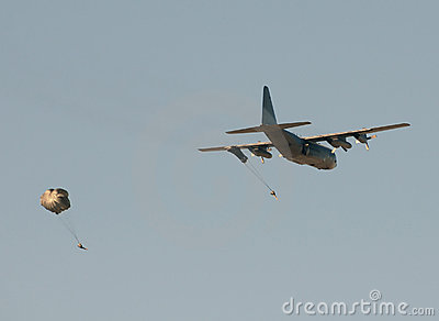 Transport airplane dropping soldiers
