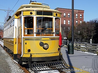 Transport: historic yellow trolley car side