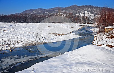 Transversing river in winter day