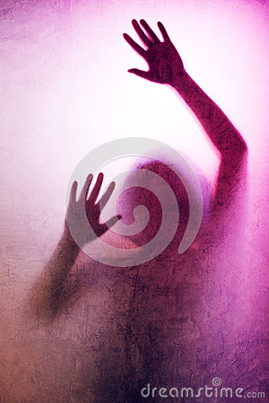 Free Trapped Woman, Back Lit Silhouette Of Hands Behind Matte Glass Stock Images - 78537264