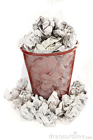 Trash bin is filled with paper waste