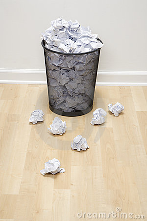 Trash can and paper.