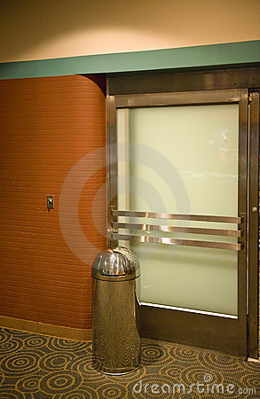 trash can by a theater door stock image image 4929611