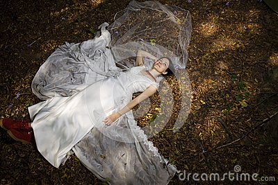 Trash the dress in autumn forest