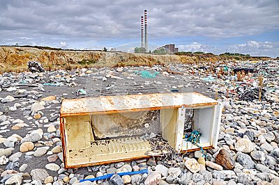 Trashed fridge on the seashore