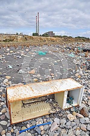 Trashed fridge on the seashore