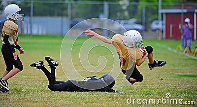 Trastos del fútbol americano de la juventud Imagen editorial