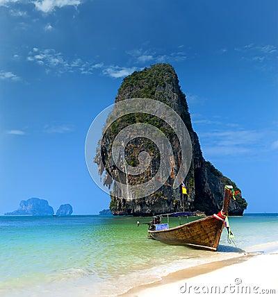 Travel boat on Thailand island beach. Tropical coast Asia landsc