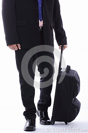 Travel businessman holding luggage