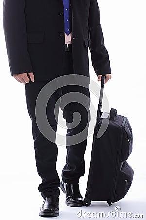Travel businessman holding luggage