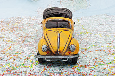 Travel by car. A toy car on the map