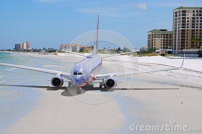 Travel concept - plane on a beach