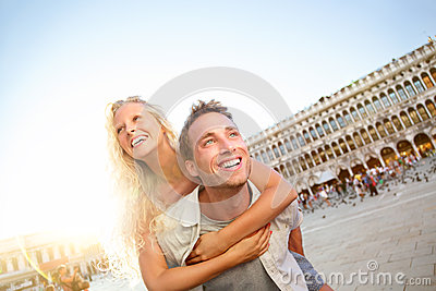 Travel couple in love having fun Venice romance