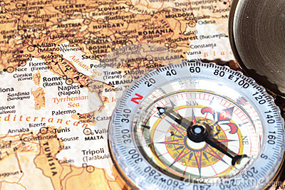 Travel destination Italy, ancient map with vintage compass