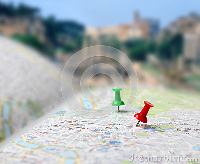 Travel destination map push pins blur