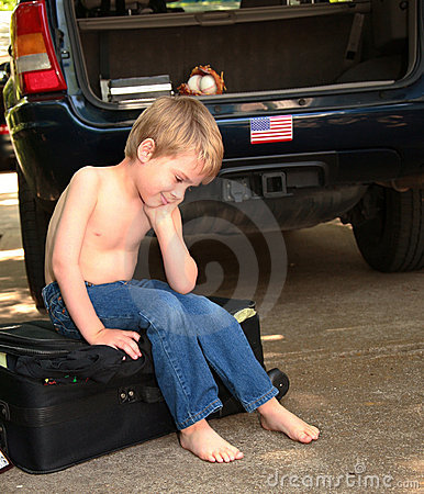 Frustrated Child Sitting on Suitcase