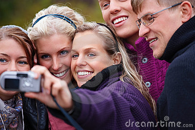 Travel - Group of modern people taking a picture