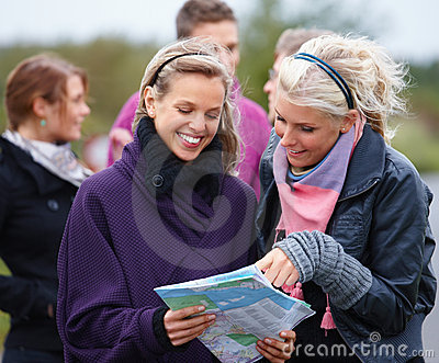 Travel - Modern young people looking at a map