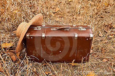 Travel suitcase and hat