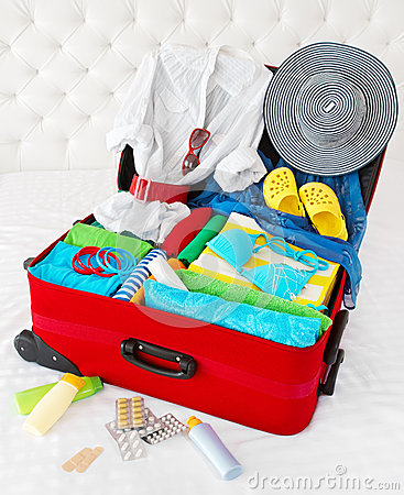 Travel suitcase packed for vacation