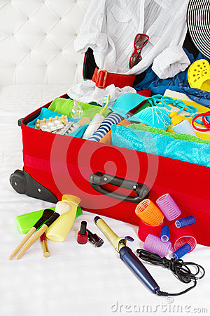 Travel suitcase packed for woman vacation