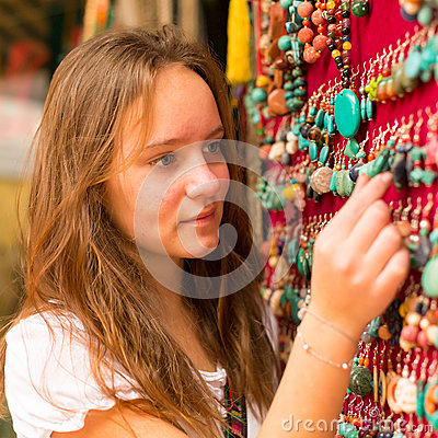 Free Travel. Teen-girl In The Asian Gift Shop. Royalty Free Stock Photos - 36279398