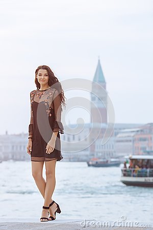 Free Travel Tourist Woman On Pier Against Beautiful View On Venetian Chanal In Venice, Italy. Royalty Free Stock Photos - 113283618