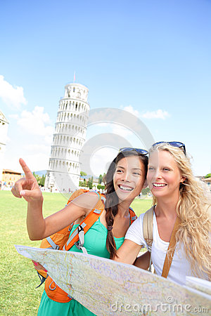 Travel tourists friends holding map in Pisa, Italy