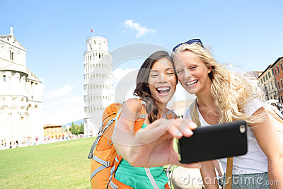 Travel tourists friends taking photo in Pisa