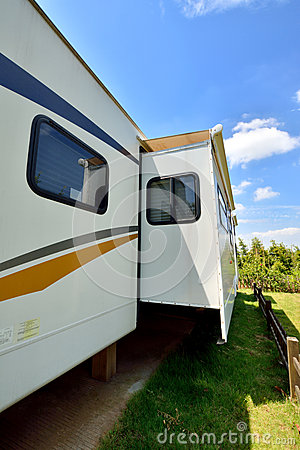 Travel trailer in camp in sunshine day