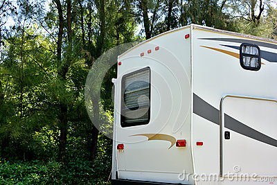 Travel trailer in forest camp
