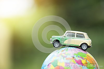 Travel and transport concept. Toy car on world map balloon Stock Photo