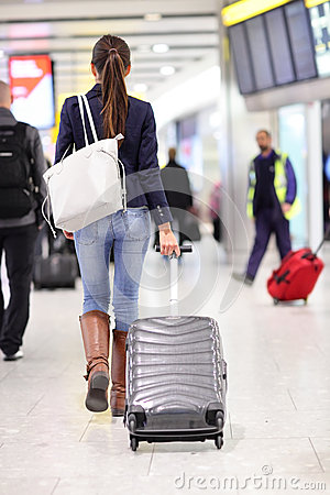 Free Travel Woman Walking In An Airport With Luggage Stock Photo - 38170450