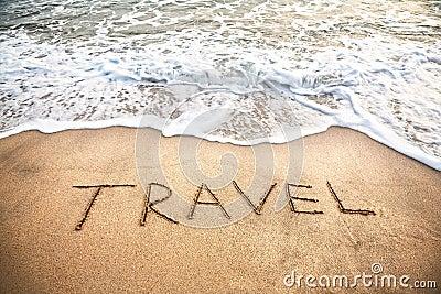 Travel word on the beach