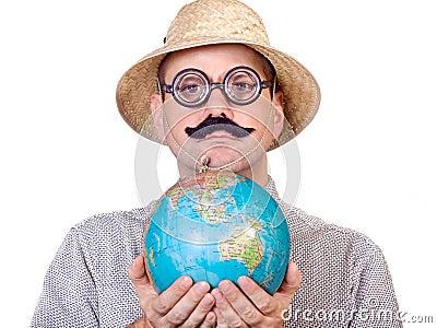 Traveler holding globe