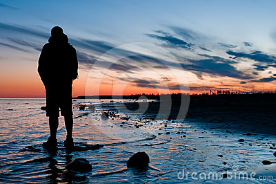 Traveler looking on sunset