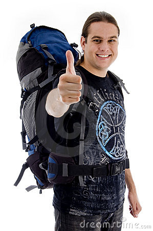 Traveler with rucksack and thumbs up