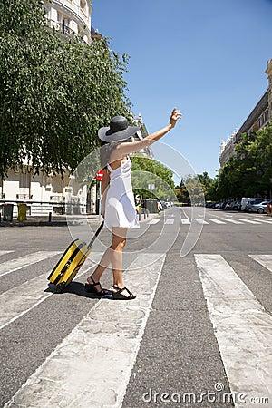 Traveler woman calling a taxi