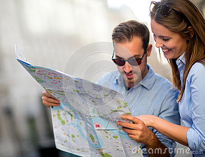 Travelers looking at a map